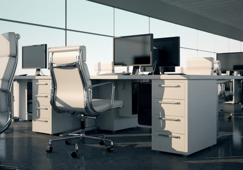 Side view of an office sets. White armchairs and desks with a monitors on top. Illustrates arrangement and furnishing of a modern office interior, comfortable business space and professionalism.